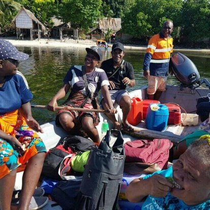 Research team travelling via boat in Solomon Islands